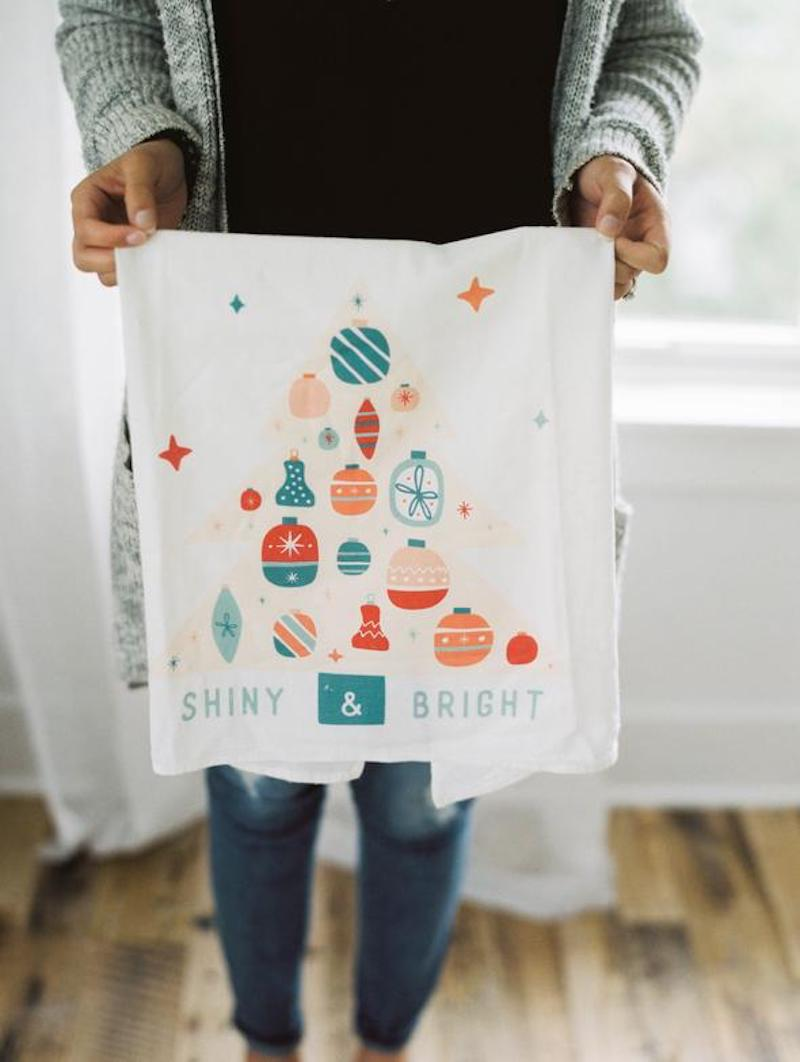 "Flour sack towel with ornament design that reads ""Shiny & Bright"" from Doe a Deer Designs"