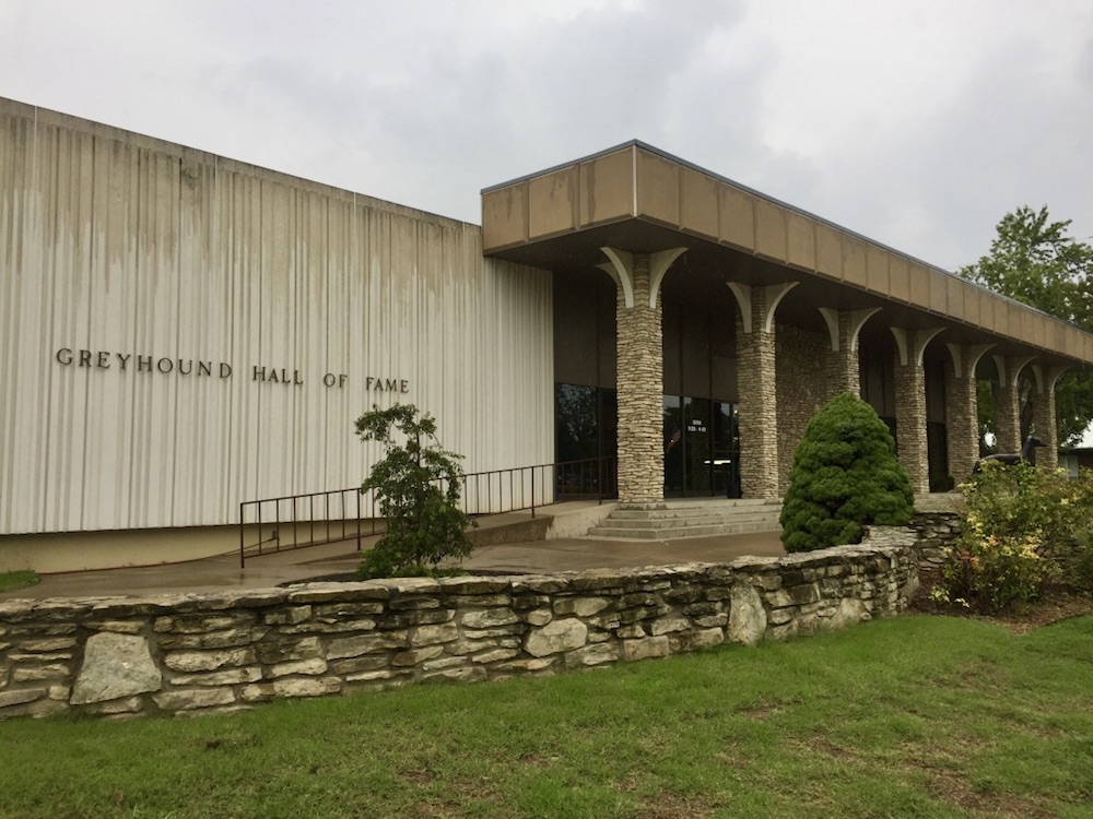 Concrete exterior with arched columns at the Greyhound Hall of Fame in Abilene, Kansas