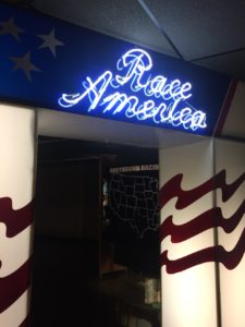 Race America blue neon sign at the Greyhound Hall of Fame in Abilene, Kansas
