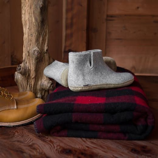 Grey wool Glerup boots with red flannel blanket