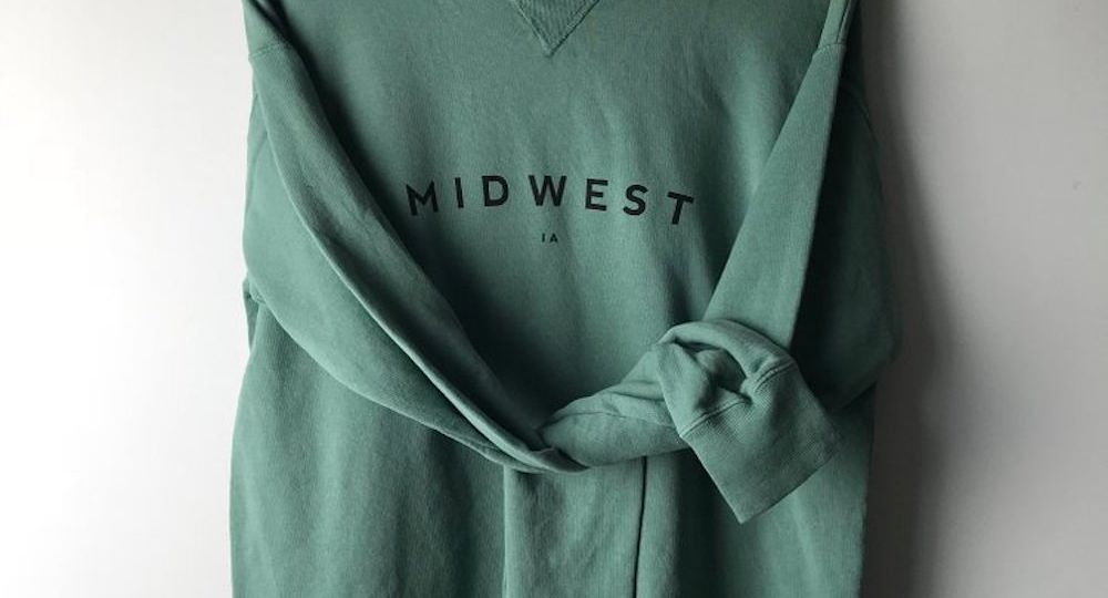 "Green crewneck sweatshirt that says ""Midwest"""