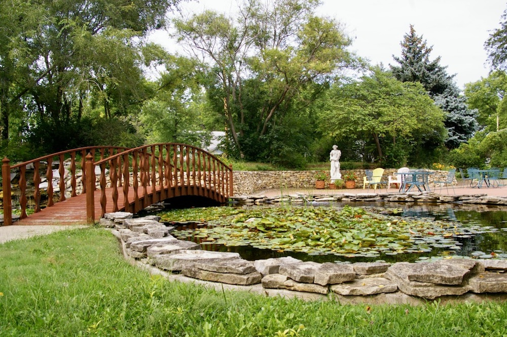 Gardens and bridge over lily pond at the Seelye Mansion in Abilene, Kansas