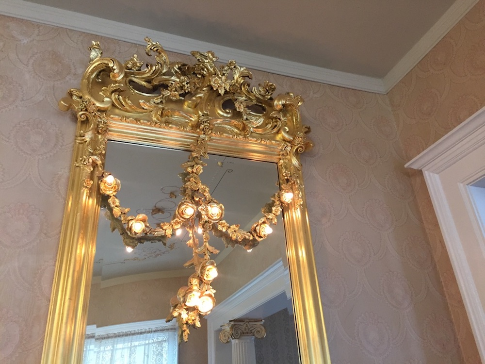 Gold plated mirror with lights at Seelye Mansion in Abilene, Kansas