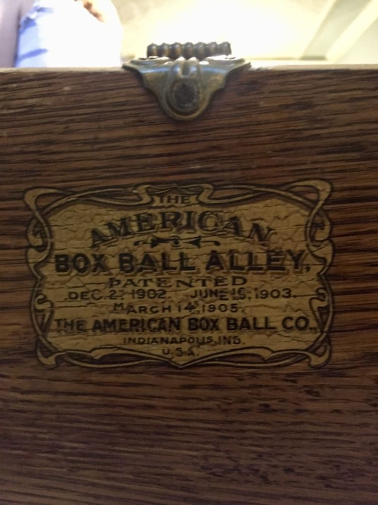 Seal on a wooden box ball bowling alley in the basement of the Seelye Mansion in Abilene, Kansas