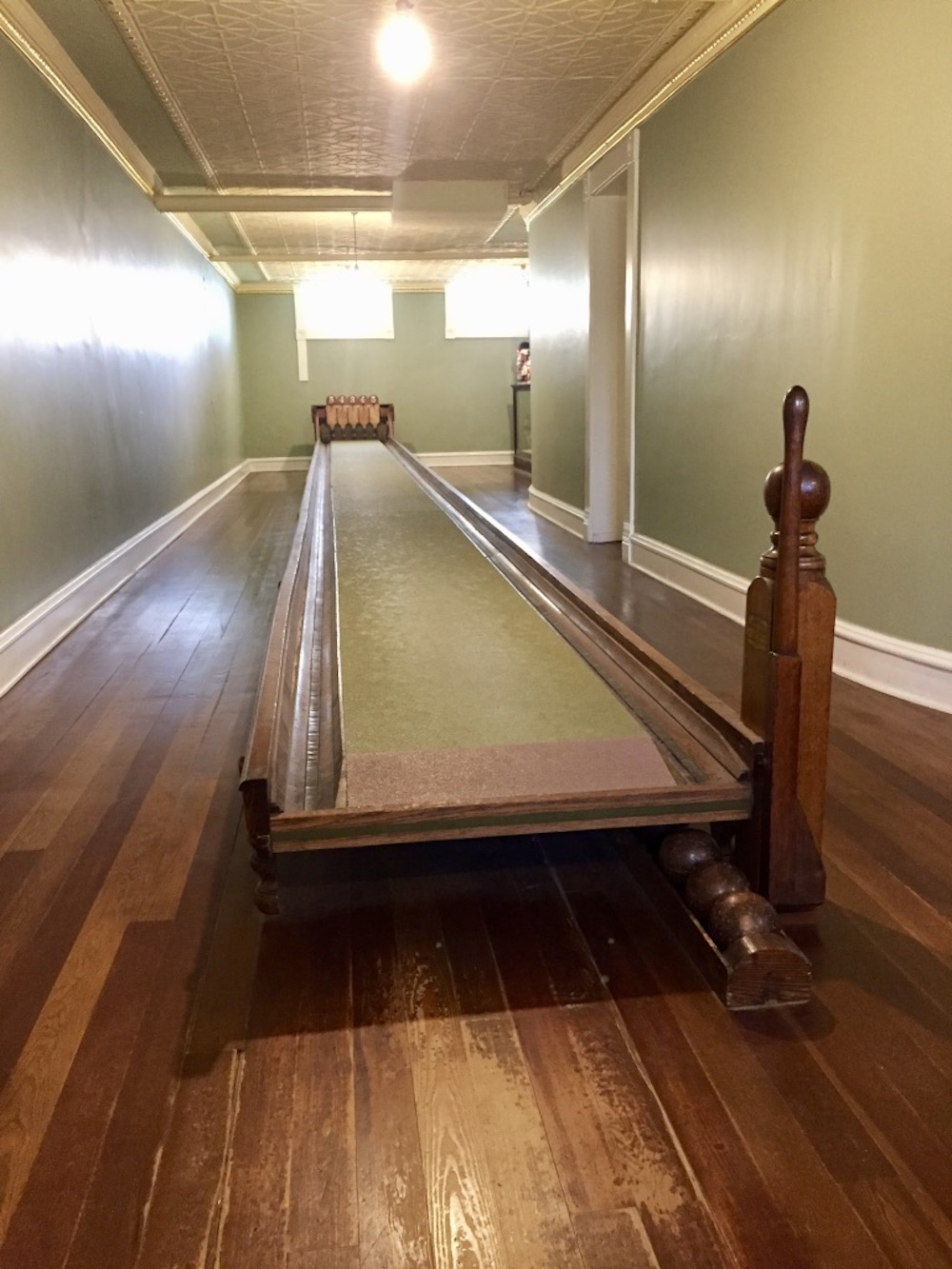 Wooden box ball bowling alley in the basement of the Seelye Mansion in Abilene, Kansas