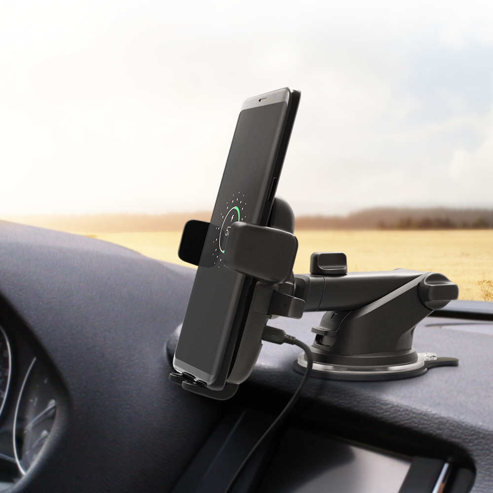 Black mounted phone holder on a car dashboard
