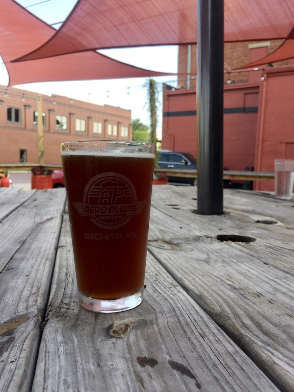 Pint of beer on the patio of AeroPlains Brewery in Wichita, Kansas