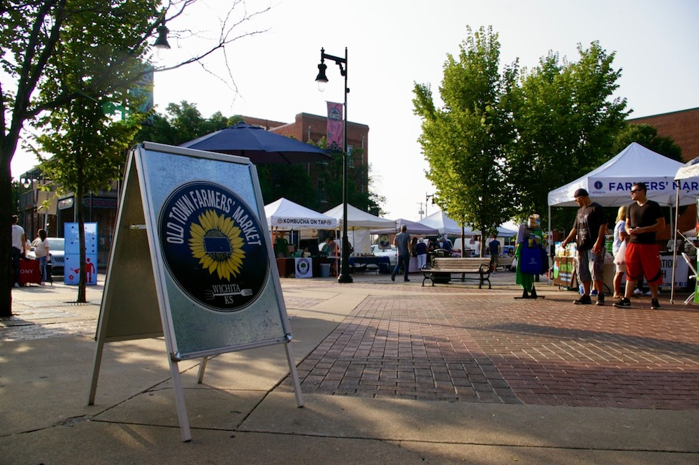 Metal sandwich board sign with the logo for the Old Town Farmers' Market in Wichita, Kansas