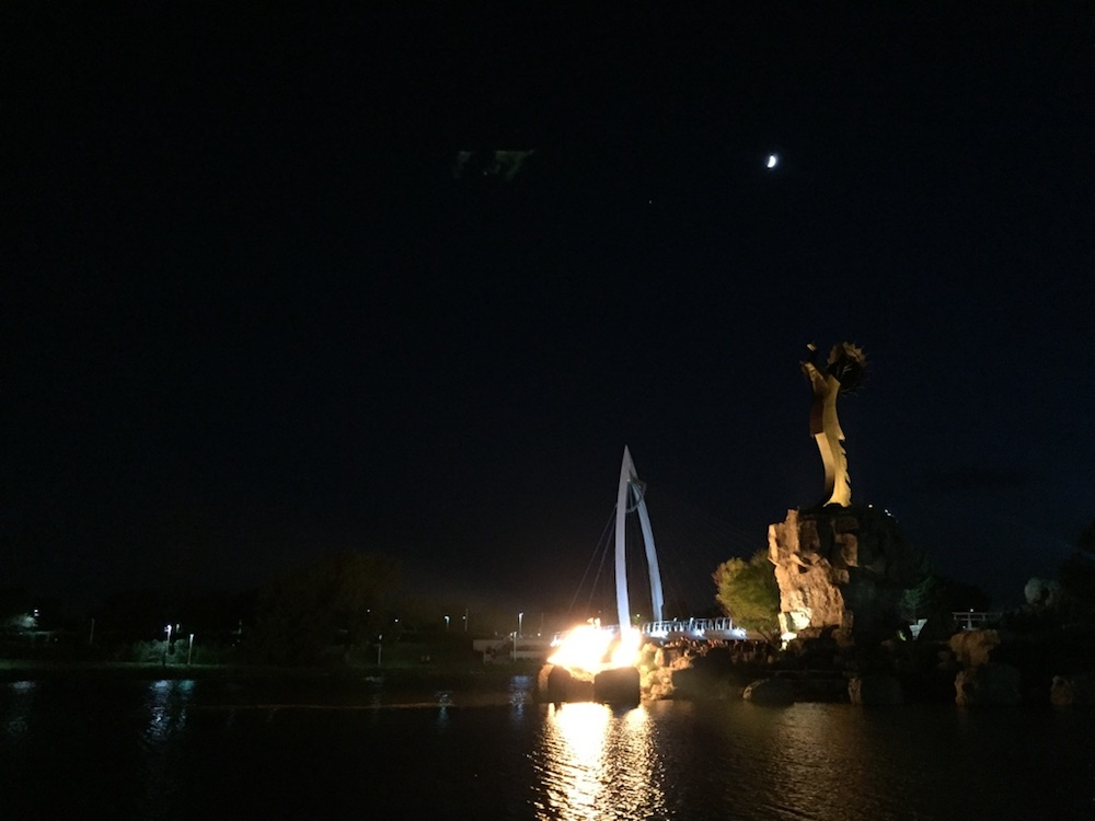 Keeper of the Plains illuminated by firelight at night in Wichita, Kansas