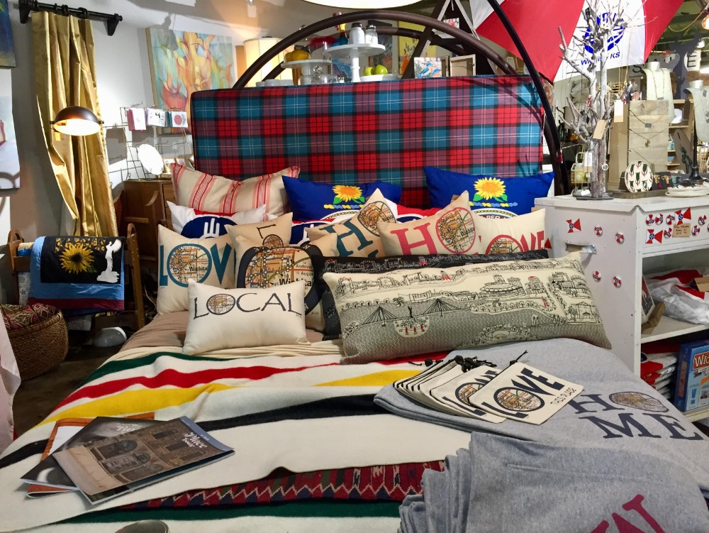 Kansas and Wichita themed bedding on display at The Workroom in Wichita, Kansas