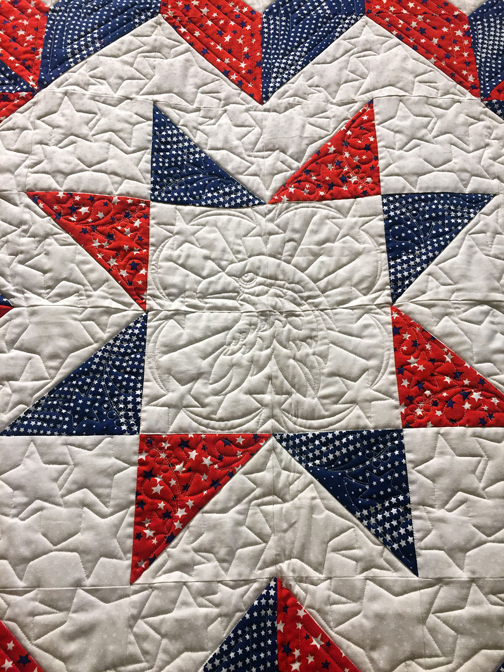 Detail of a red, white and blue embroidered quilt at the Iowa Quilt Museum in Winterset, Iowa
