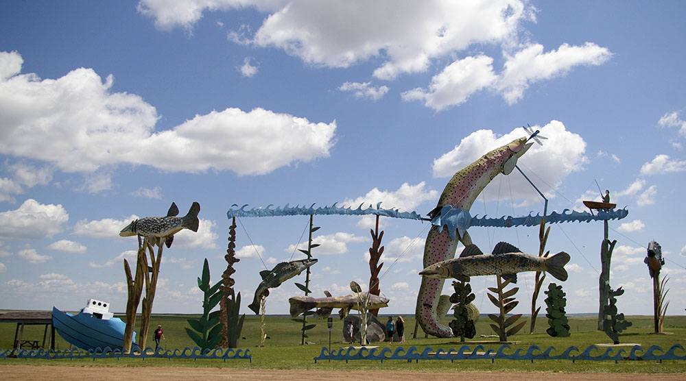 Large metal sculptures of fish jumping along the Enchanted Highway near Regent, North Dakota