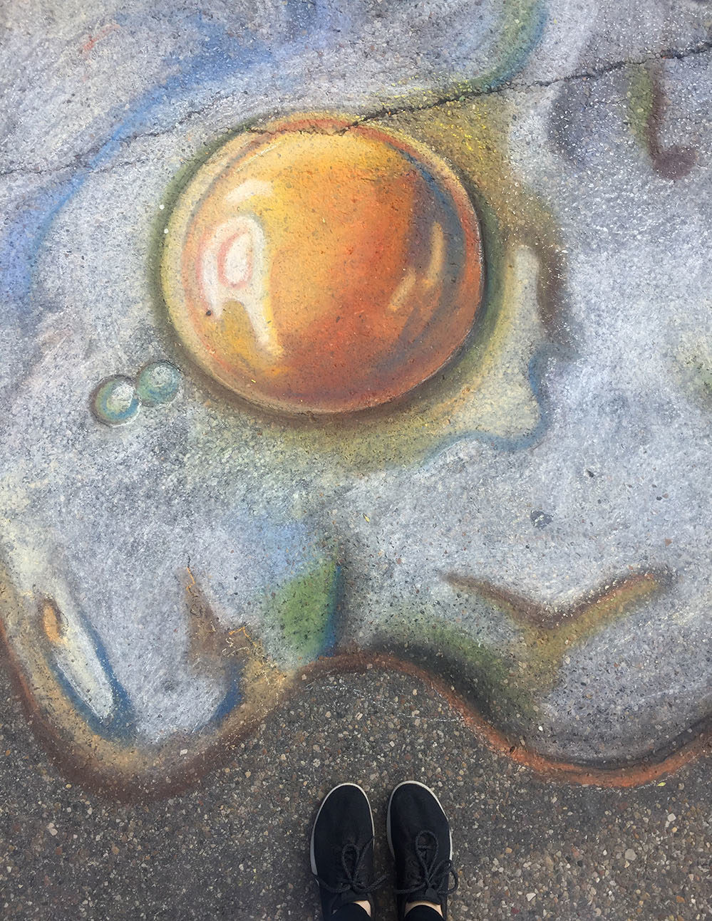 Egg and yolk drawn with chalk during Mount Vernon's 2019 Chalk the Walk