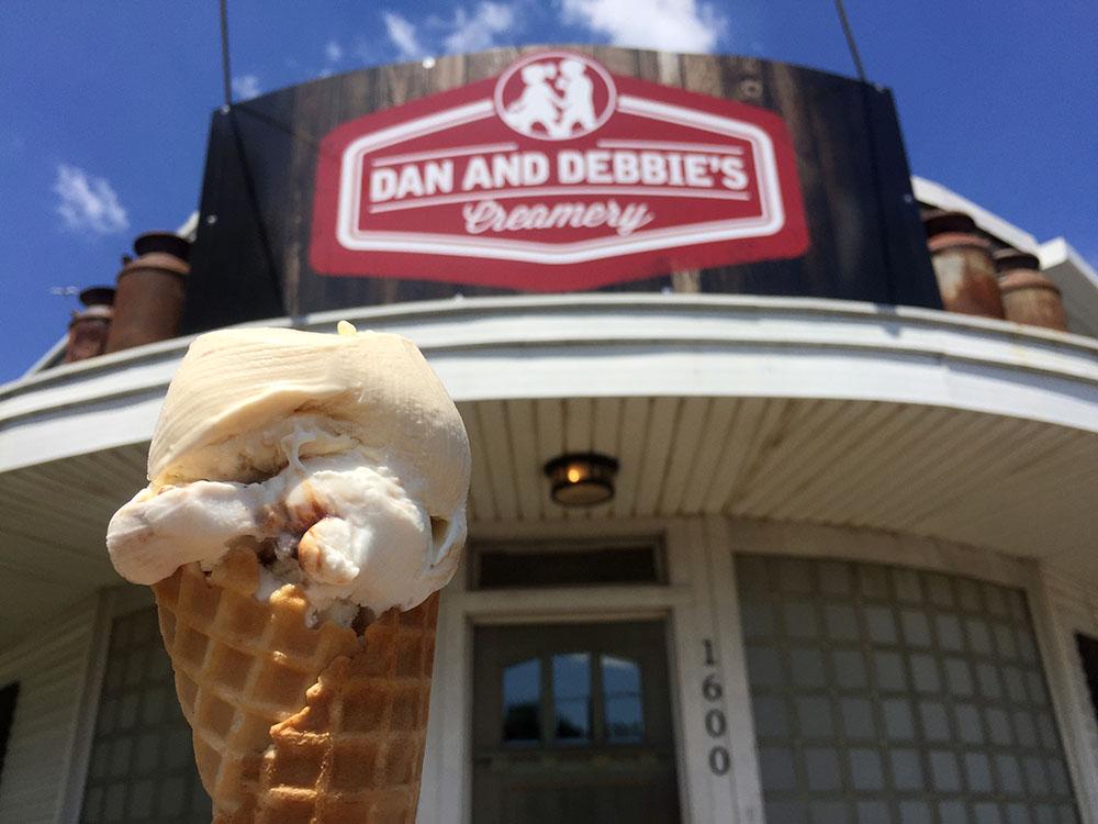 Caramel ice cream cone in front of Dan & Debbie's sign in Ely, Iowa
