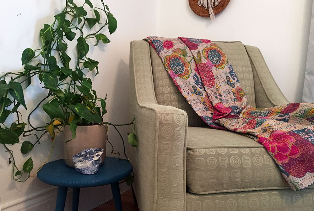 Climbing pothos plant with armchair and colorful blanket at Thistle's Summit in Mount Vernon, Iowa