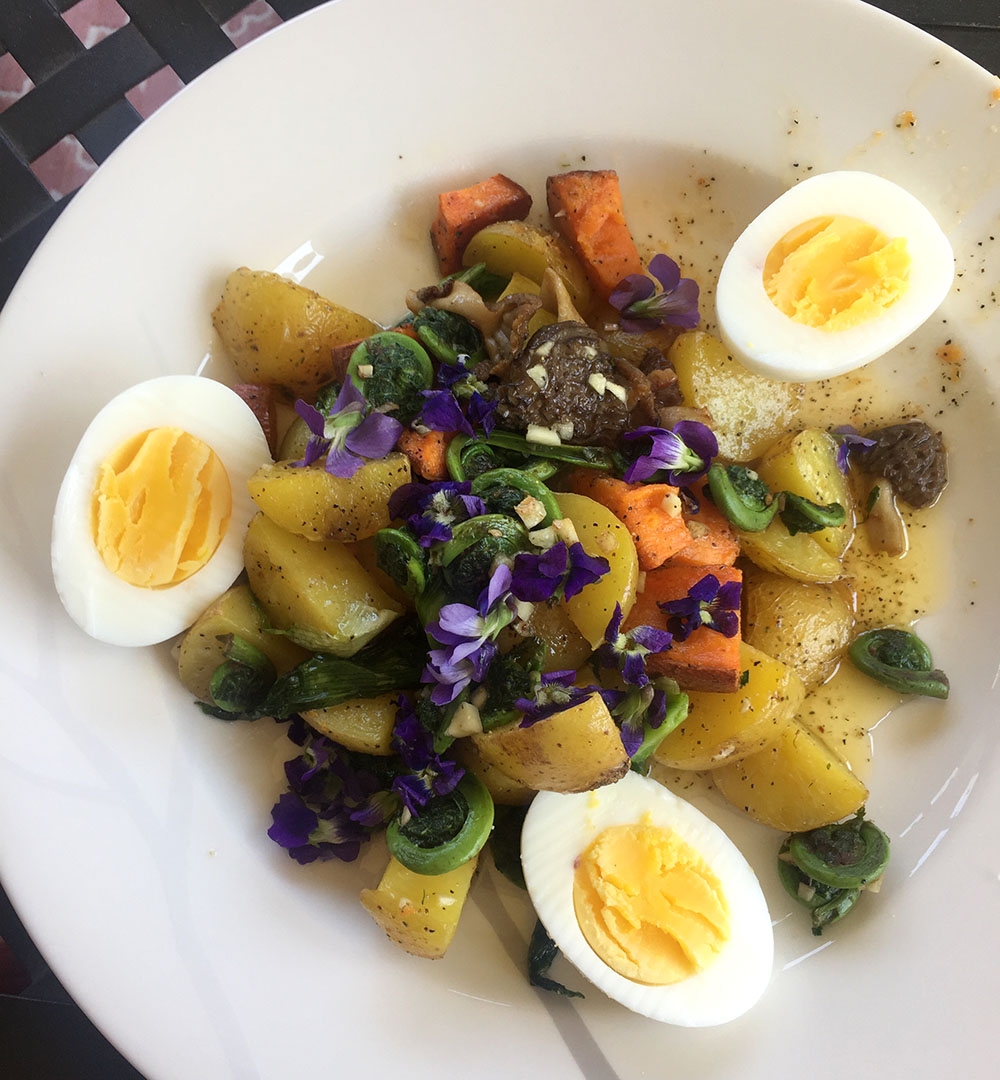 Warm root vegetable salad with hard boiled eggs and morel mushrooms at Thistle's Summit in Mount Vernon, Iowa
