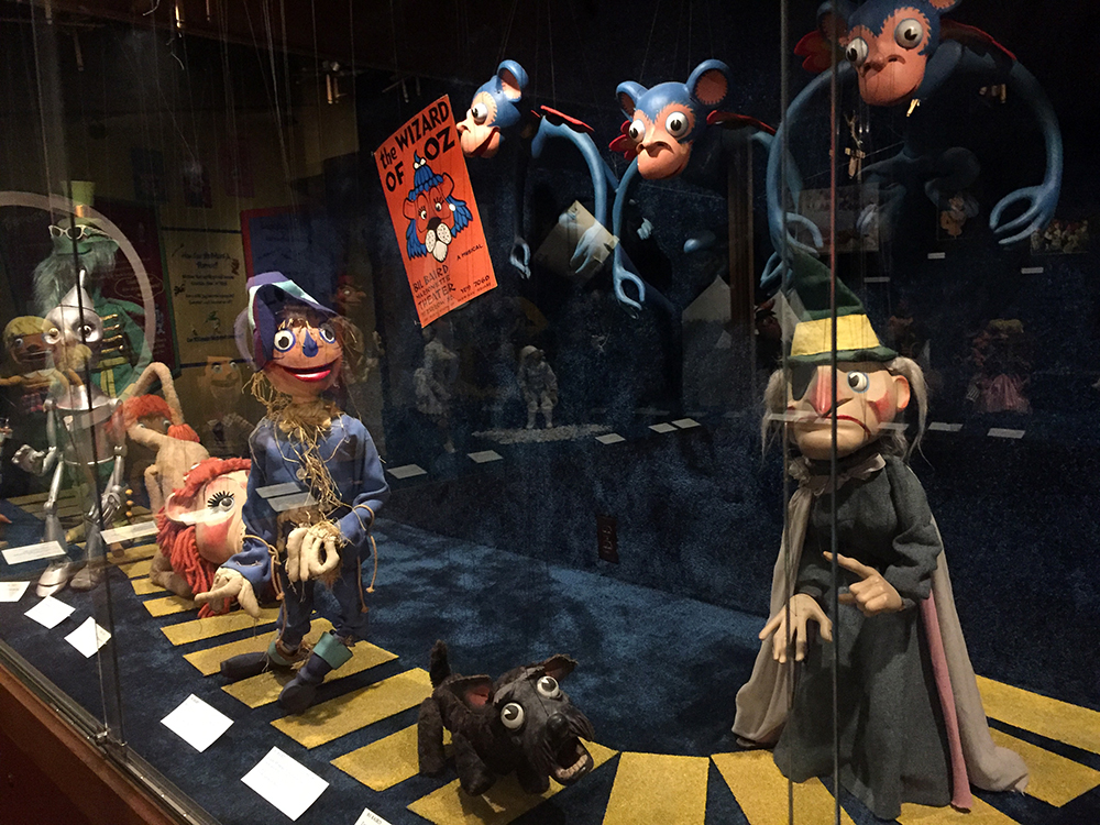 Seven Wizard of Oz themed marionette puppets made by Bil Baird on display at the Charles H. MacNider Art Museum in Mason City, Iowa