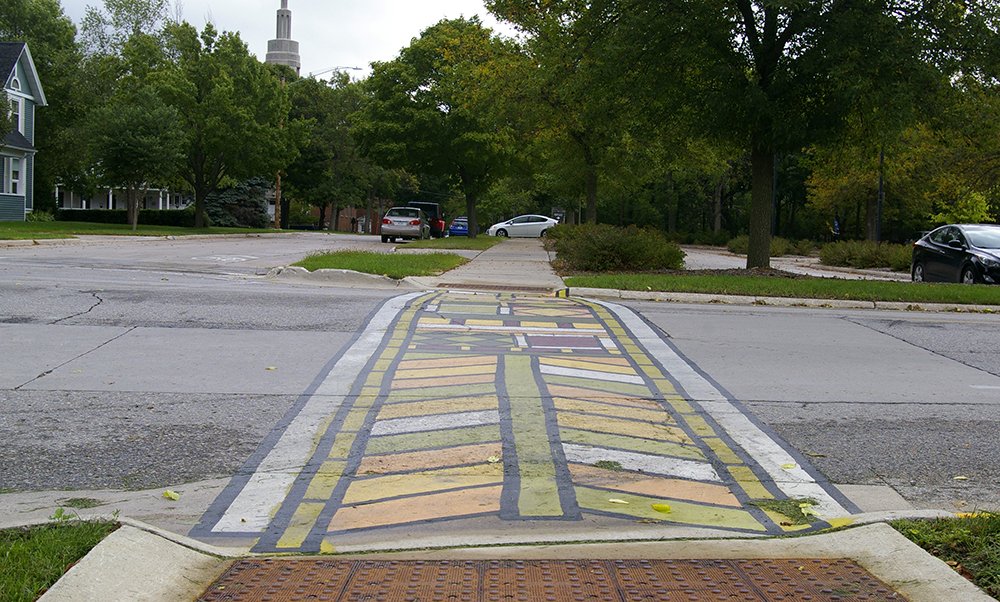Crosswalk painted with Frank Lloyd Wright inspired design in Mason City, Iowa