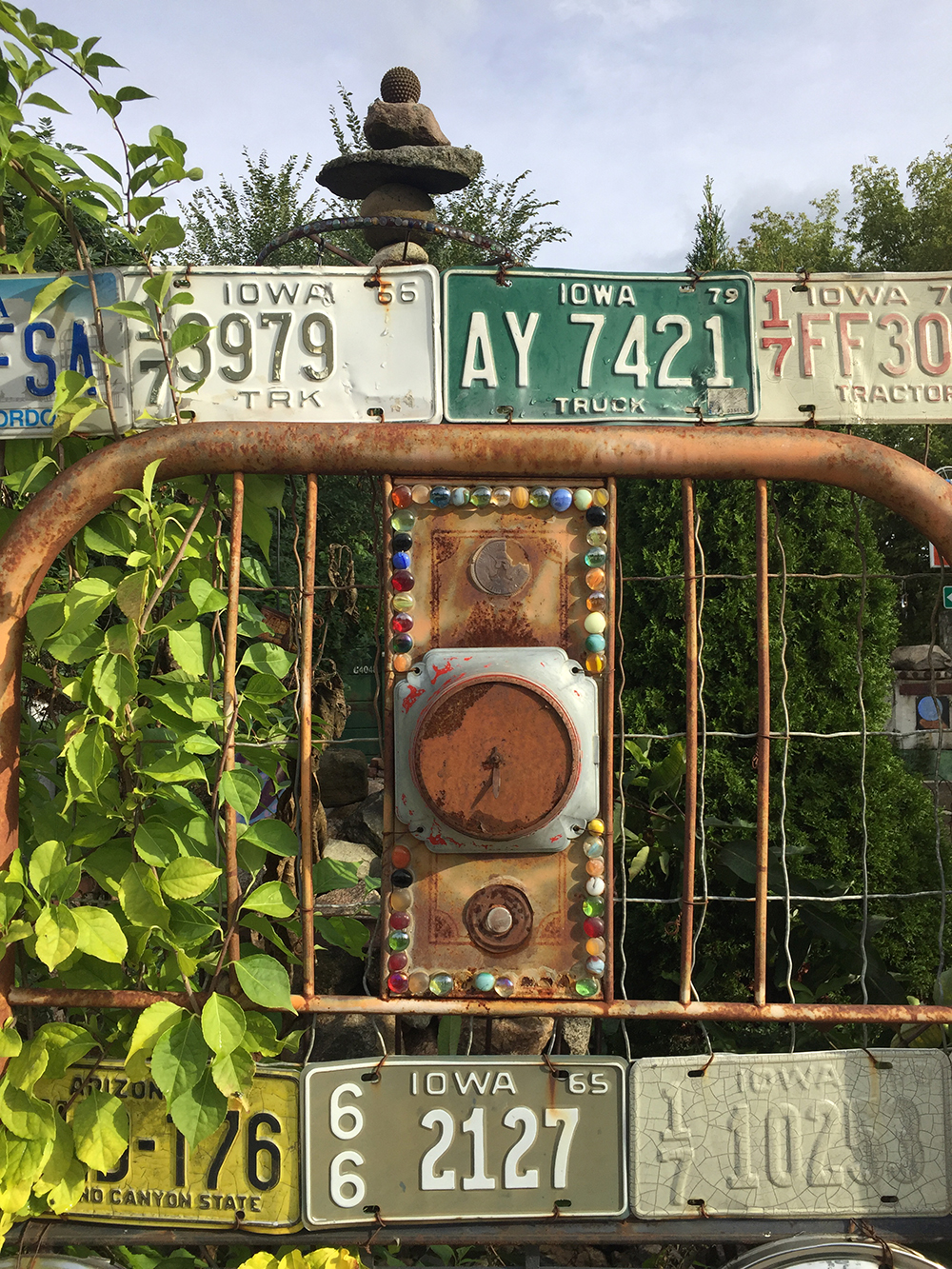Fence created from license plates, gems, coins and more at the Rancho Deluxe in Mason City, Iowa