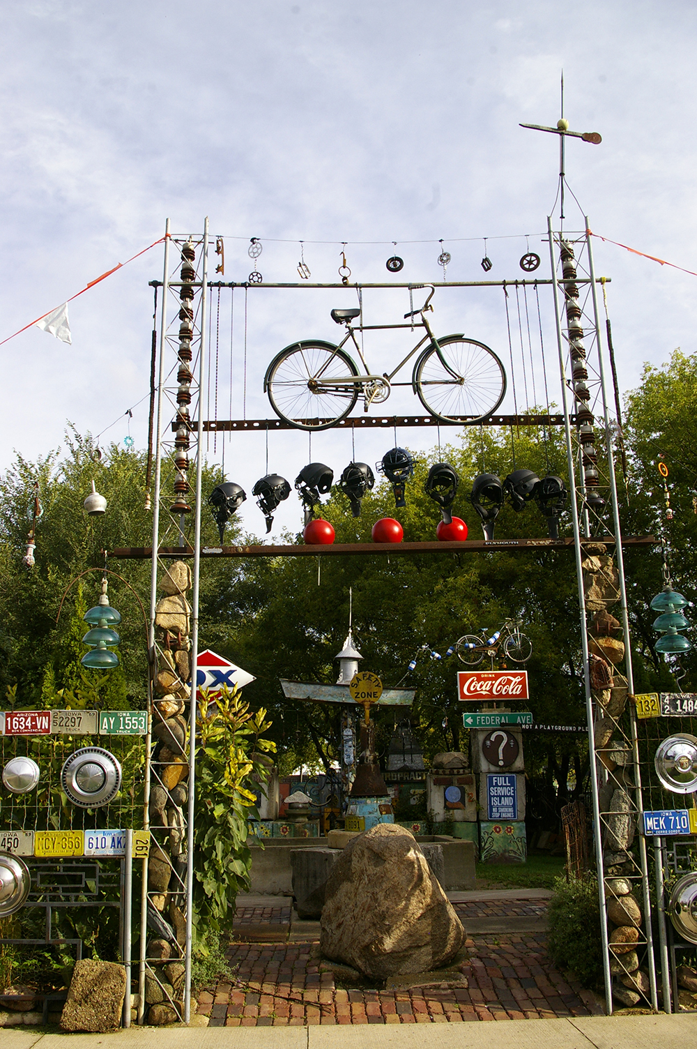 Folk art gate created from bicycle, rocks, old helmets and more at the Rancho Deluxe in Mason City, Iowa