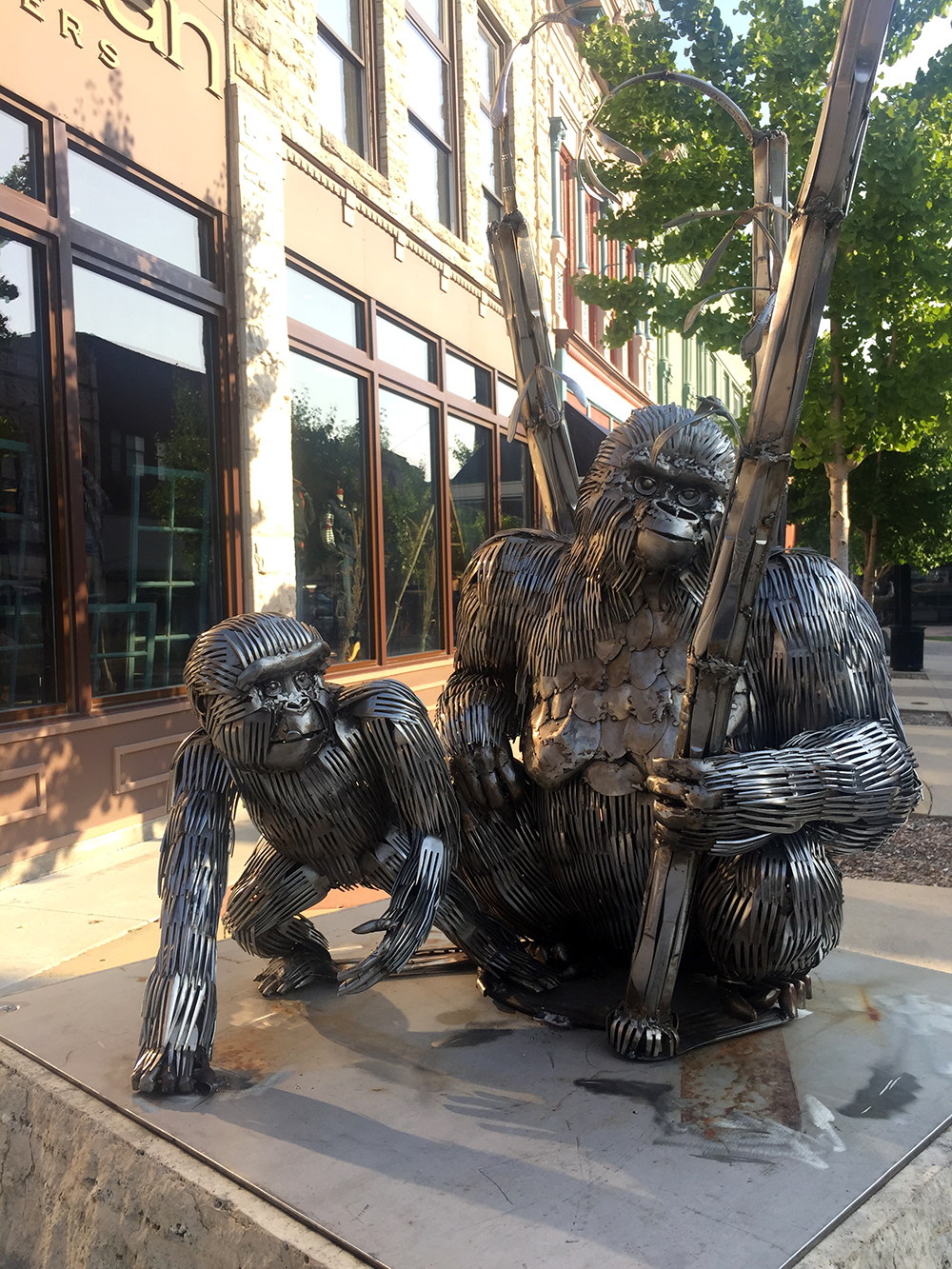 Two gorillas made from metal utensils along the River City Sculptures on Parade in Mason City, Iowa