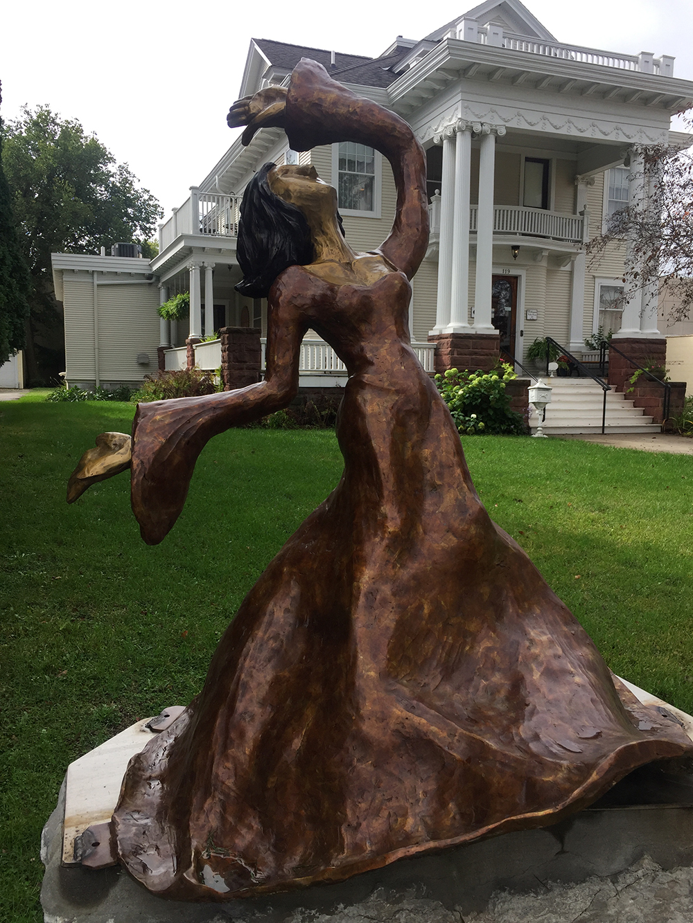 Bronze sculpture of woman dancing on the River City Sculptures on Parade in Mason City, Iowa