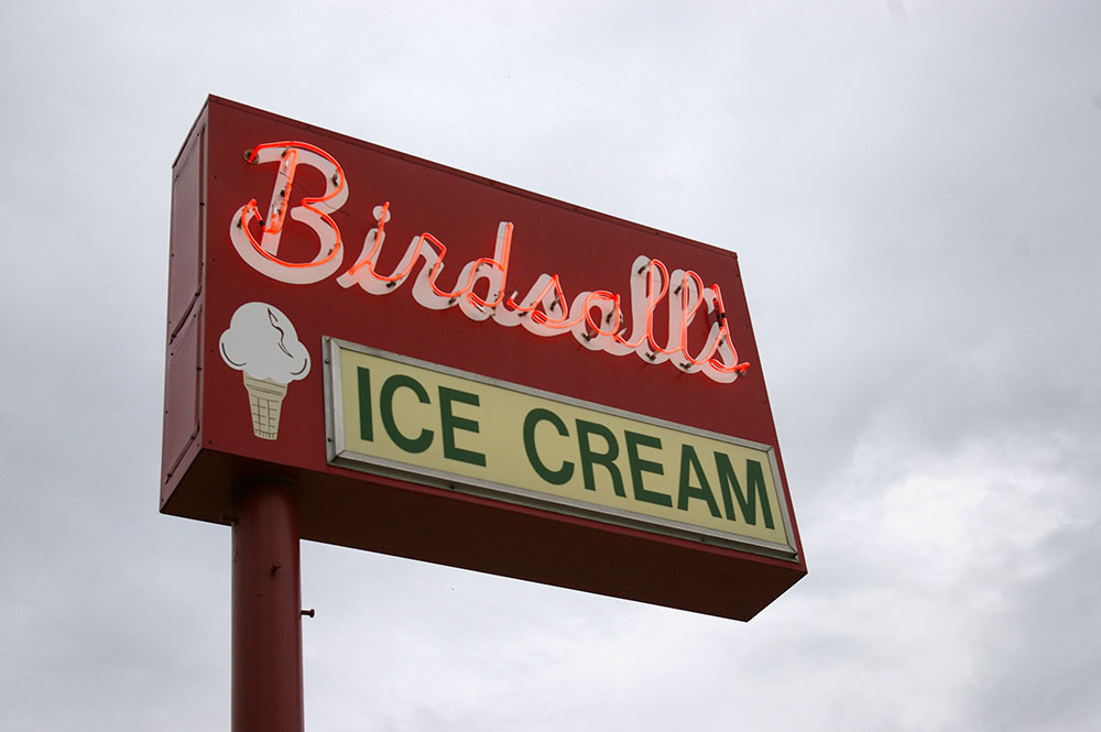 Red neon sign reading Birdsall's Ice Cream in Mason City, Iowa