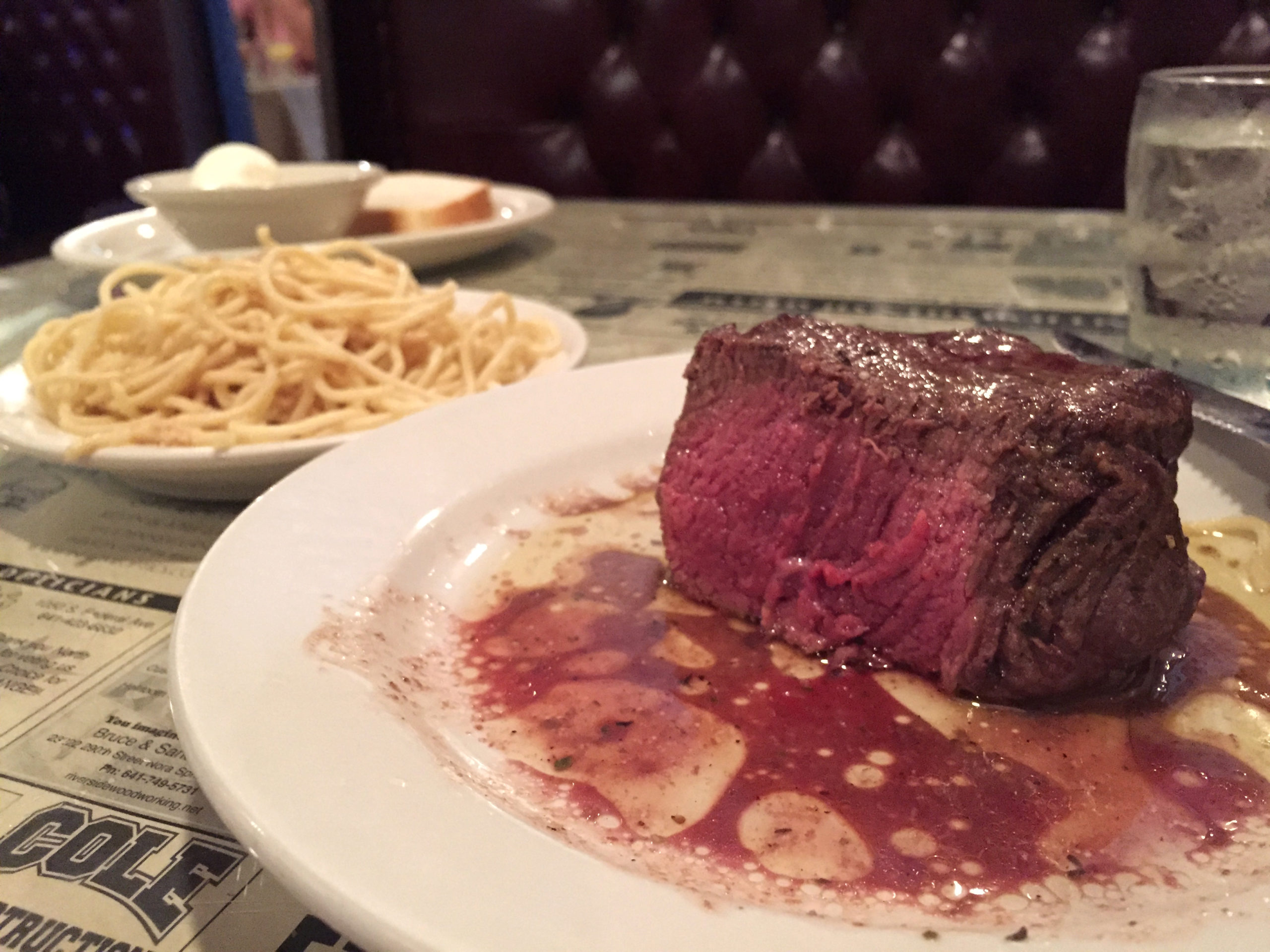 Medium rare steak with side of Greek spaghetti at Northwestern Steakhouse in Mason City, Iowa