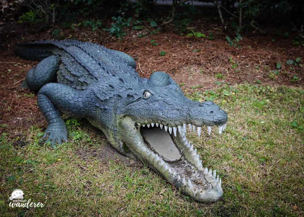 Large concrete statue of an alligator on Alabama's Gulf Coast