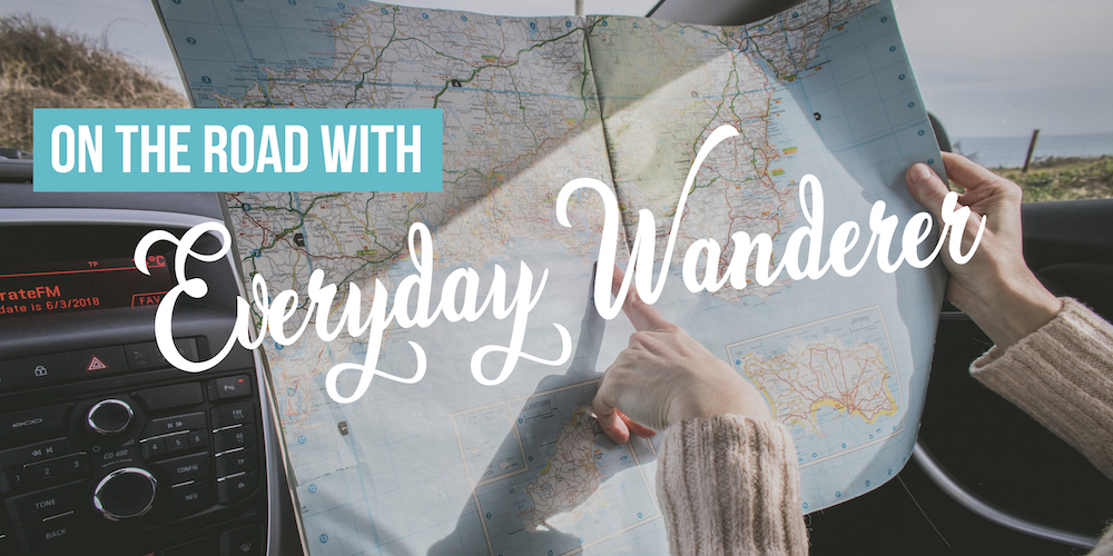 "Graphic reading ""On the Road with Everyday Wanderer"" with photo of map in the background"