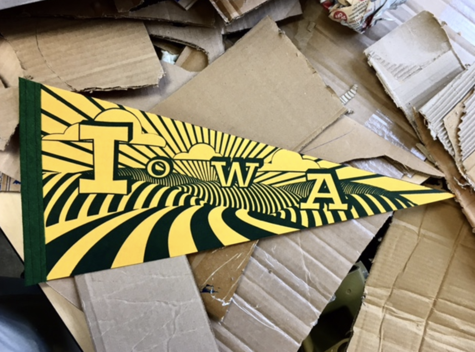 Yellow and green pennant that says Iowa made by Hook & Loop