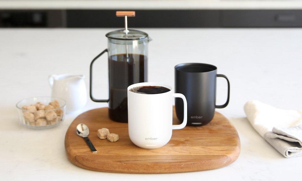 Two Ember mugs on a tray with a coffee French press