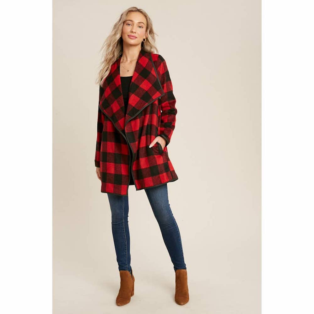 Woman wearing a red and black buffalo check coat