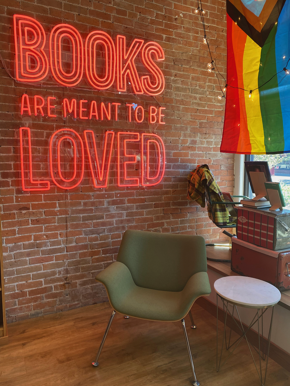 Books are Meant to Be Loved neon sign at Dogeared Books in Ames, Iowa
