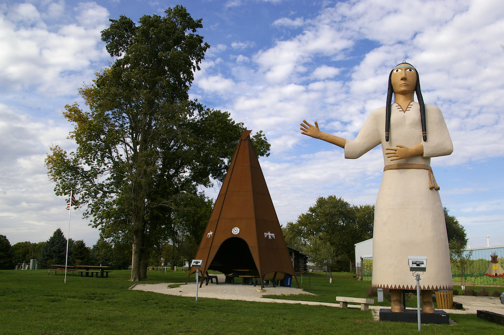 Statue of the World's Largest Pocahontas next to a giant metal teepee in Pocahontas, Iowa