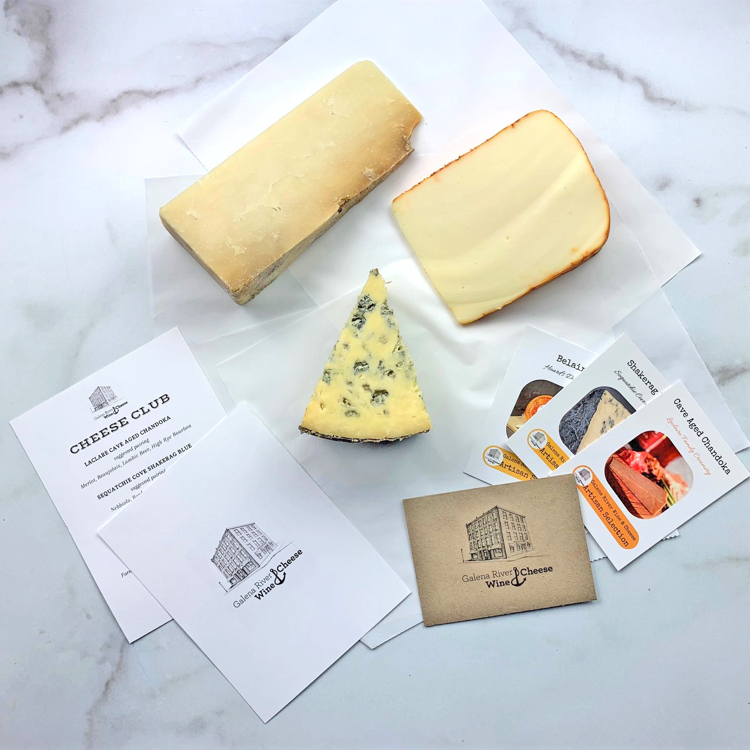 Cheese and informational cards from Galena River Wine & Cheese's monthly Cheese Club box