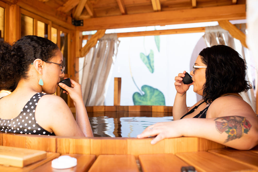 Two people sitting in hot tub