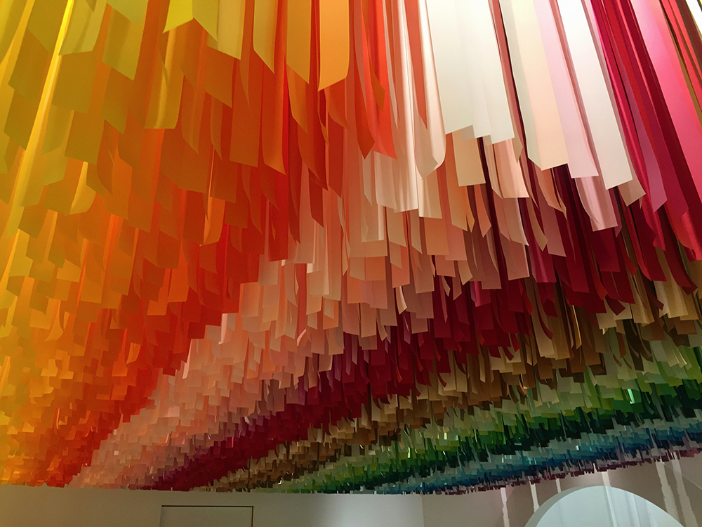 Rainbow streamer installation at the Color Factory in New York City, New York