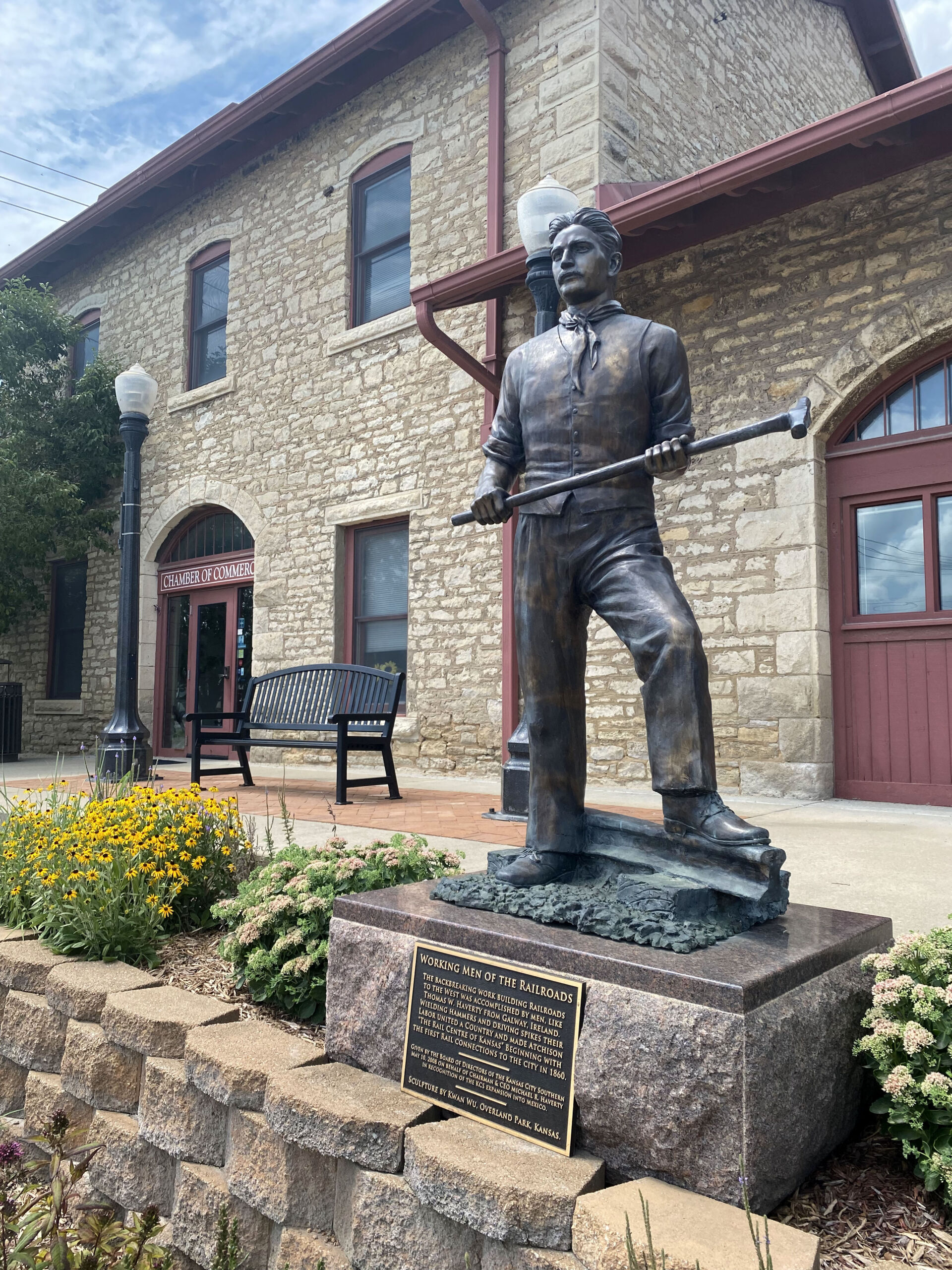 Statue of railroad worker in front of the Atchison County Historical Museum in Atchison, Kansas