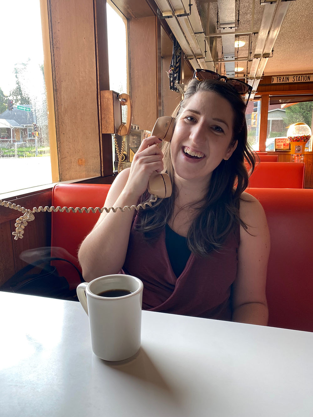 Woman ordering on telephone while sitting in booth at Fritz's Railroad Restaurant in Kansas City, Kansas