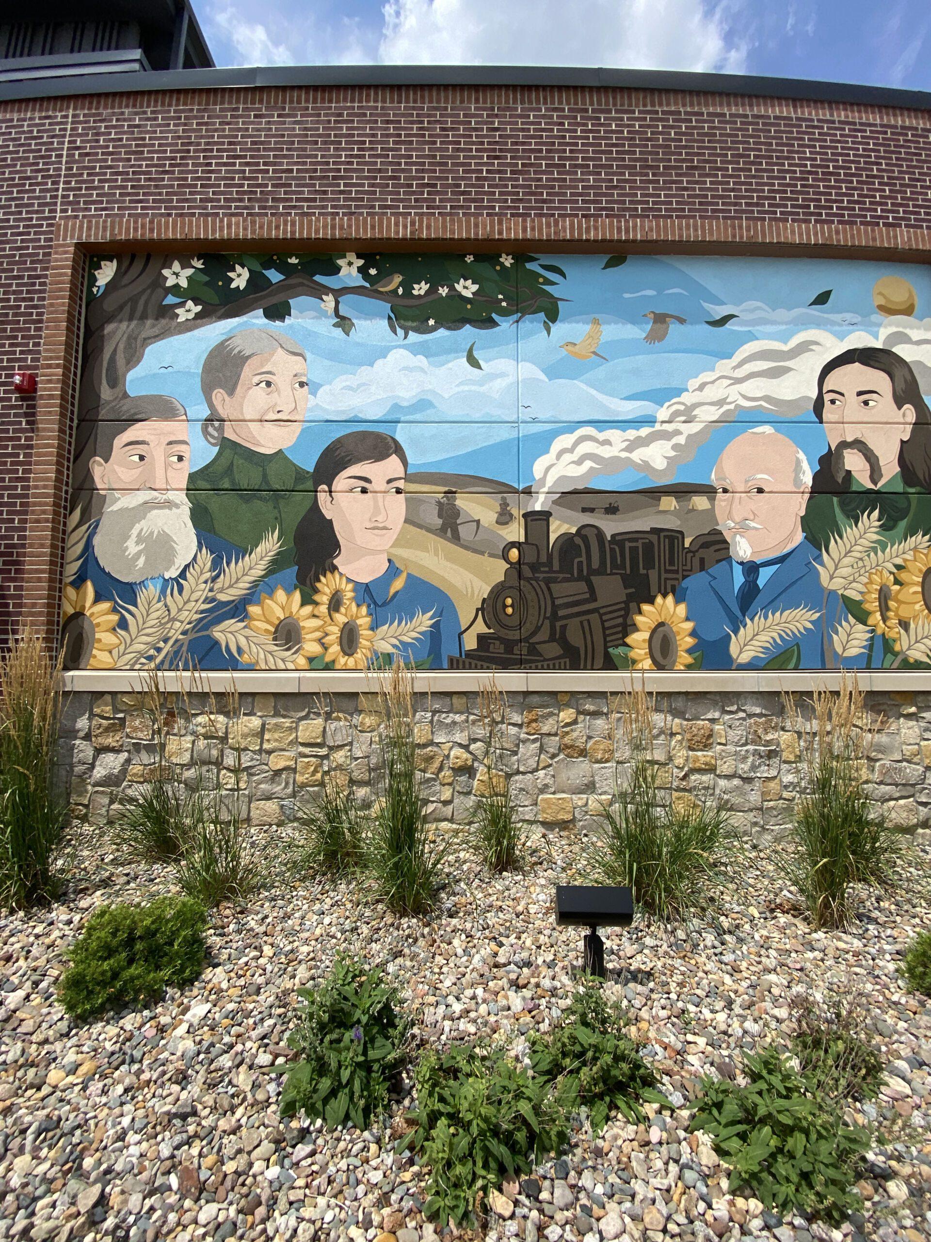 Mural of Gomer's namesake family outside of Gomer's of Kansas City in Lenexa, Kansas