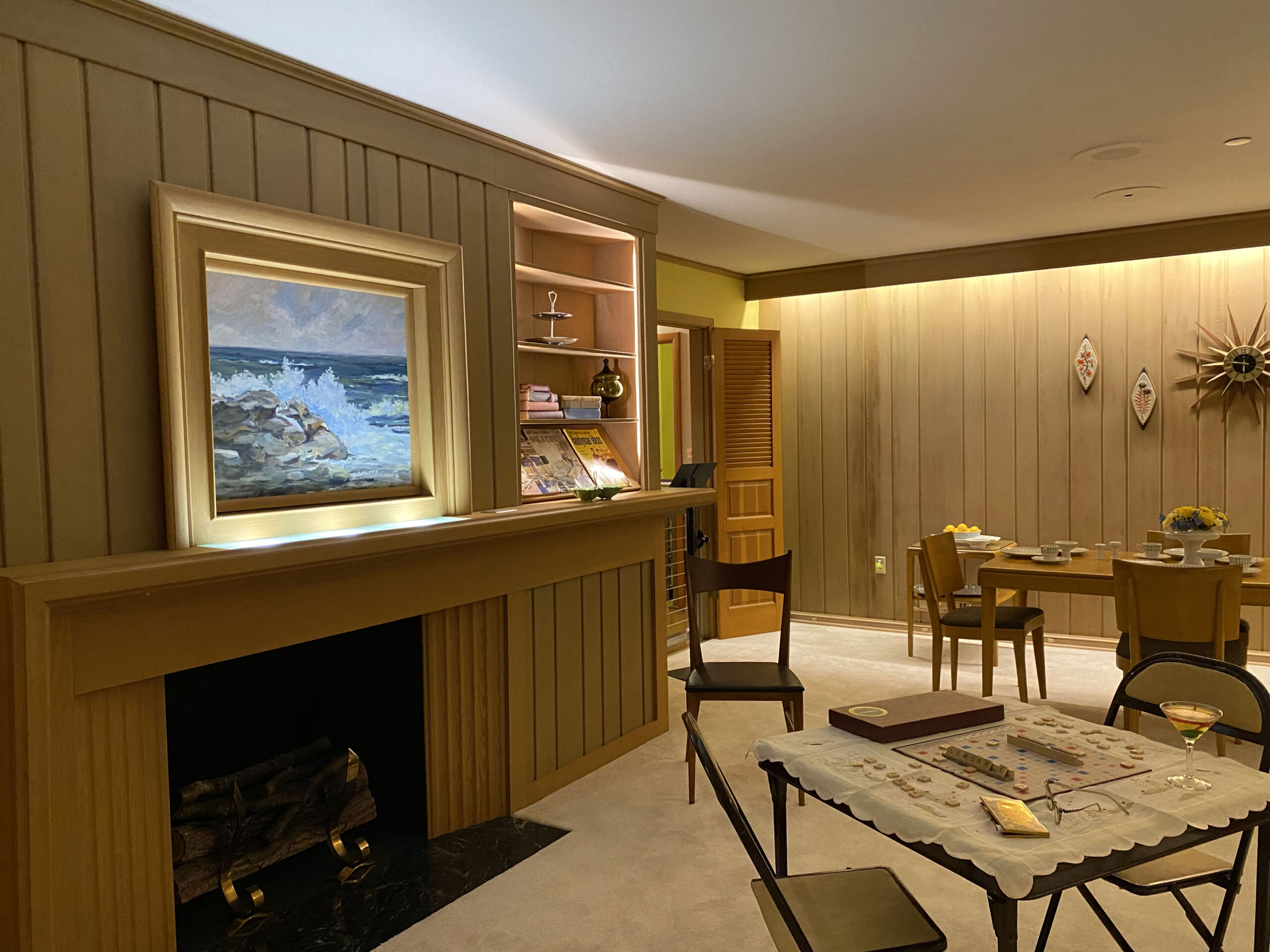 Living room including hidden TV over fire place in the 1950s All-Electric House at the Johnson County Museum in Overland Park, Kansas